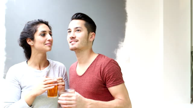 Couple talking and laughing while drinking tea video