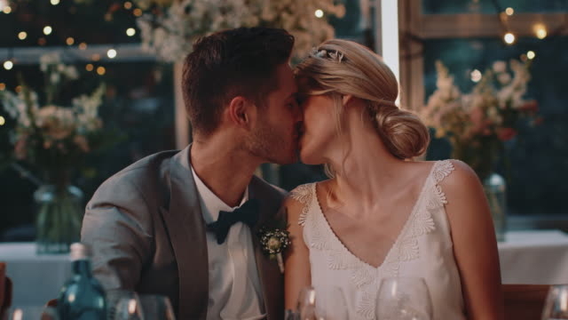 couple toasting wineglasses and kissing in wedding - young couple wedding friends video stock e b–roll
