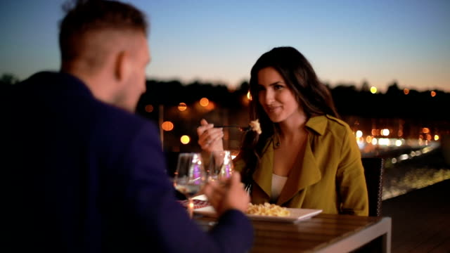Couple toasting wineglasses at restaurant table video