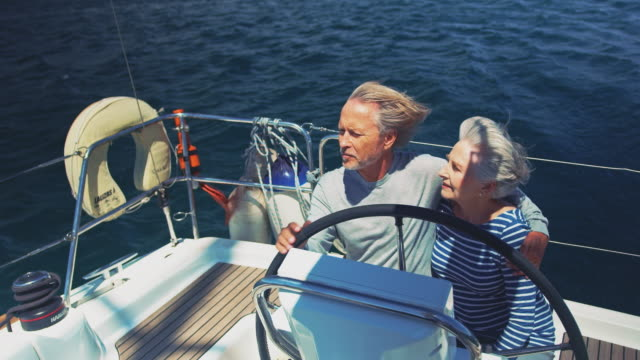 Couple traveling in yacht during summer vacation