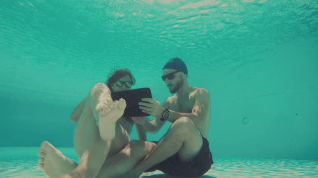 Couple uses telephone underwater video