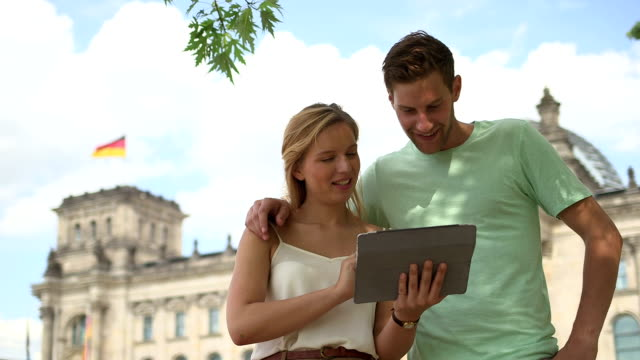 Couple using digital tablet video
