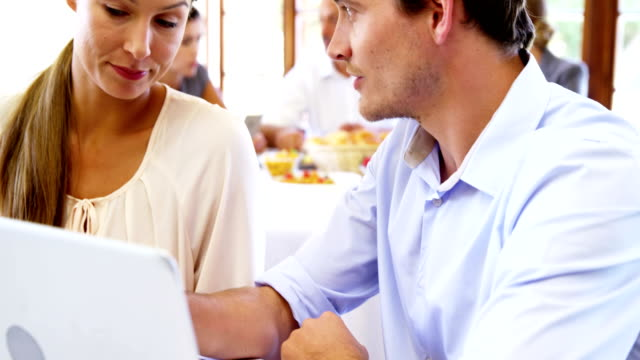 Couple using laptop Couple using laptop in restaurant 50 54 years stock videos & royalty-free footage