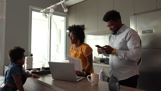 Couple using laptop working and doing home finances and talking to son Couple using laptop working and doing home finances and talking to son financial planning stock videos & royalty-free footage
