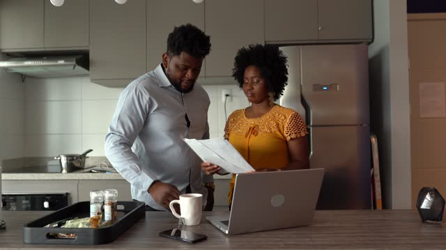 Couple using laptop working and doing home finances Couple using laptop working and doing home finances financial planning stock videos & royalty-free footage