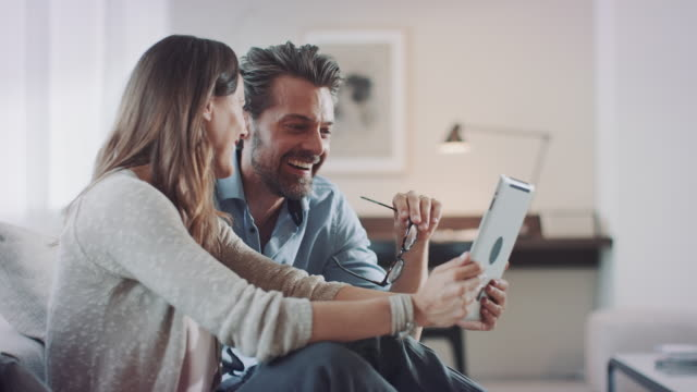 Couple using mobile devices video