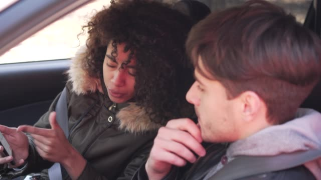 Couple using navigation on mobile phone during car road trip video