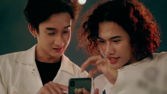 LGBTQI couple using phone stock Video video