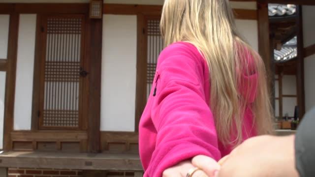 Couple visiting Bukchon Hanok Village in Seoul, South Korea