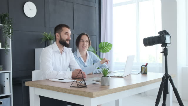 Couple vlogging about new business schemes
