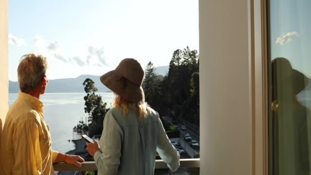 par promenad på terrassen med utsikt över sjön - blue yellow band bildbanksvideor och videomaterial från bakom kulisserna