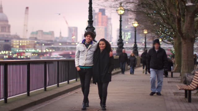 Couple Walking Along South Bank On Winter Visit To London video
