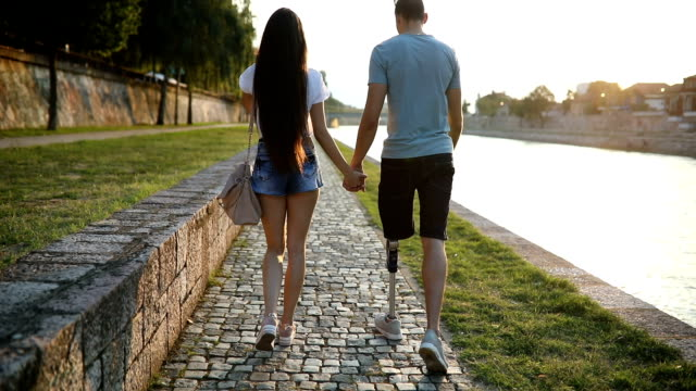 Couple walking by the river