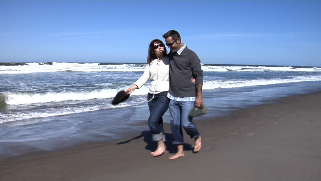 Couple walking in surf video