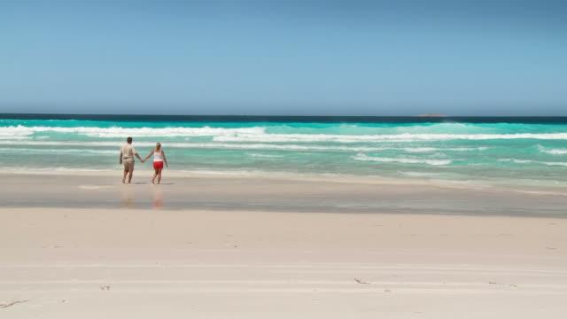 hd: couple walking on the beach - western australia stock videos & royalty-free footage