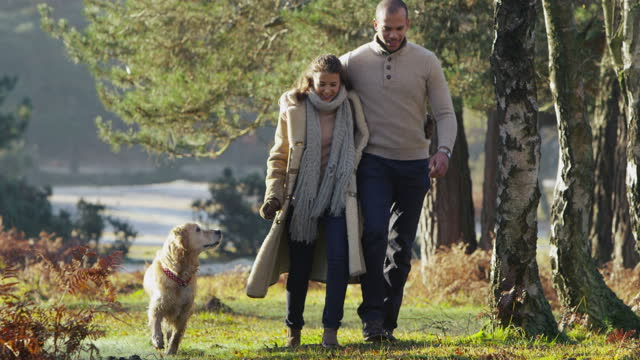 Couple walking their dog video