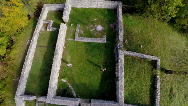 Couple walks amongst  the castle ruins video