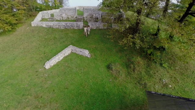 Couple walks in to the castle ruins video
