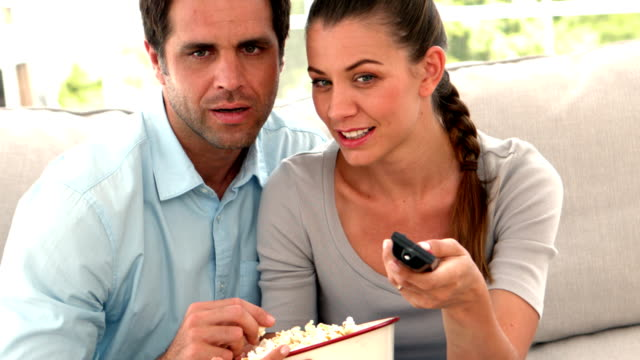 Couple watching something shocking on tv video