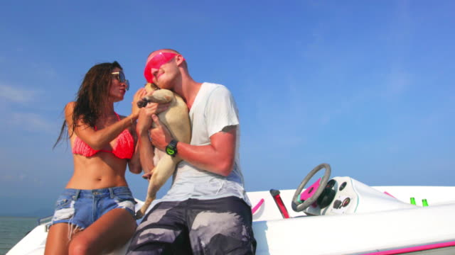 Couple with dog and boat 4K video