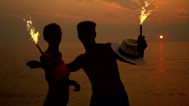 SLO MO Couple with sparklers on the beach video