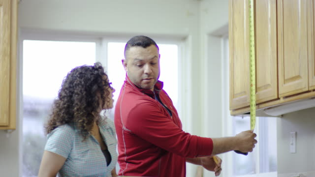 Couple working on DIY remodeling project at home video