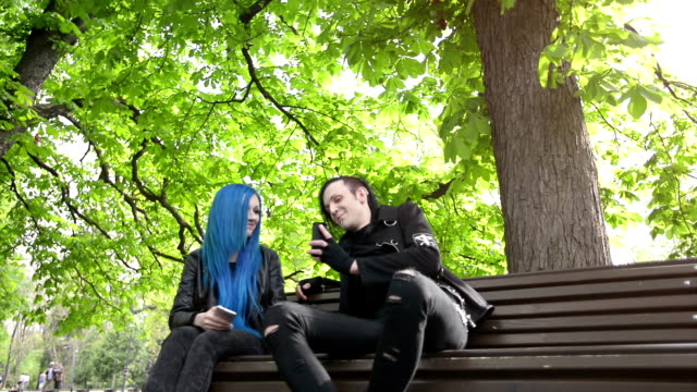 Couple young adult in the park Couple young adult in the park blue hair stock videos & royalty-free footage