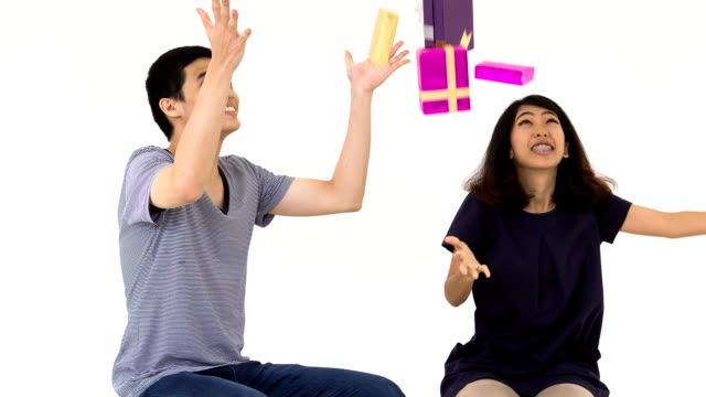 Couples tosses gift box into the air, Bullet time effect video