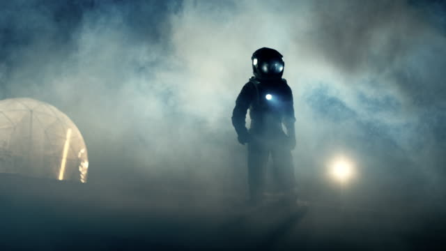 Courageous Astronaut in the Space Suit Holds Flashlight and Explores Mysterious Alien Planet Covered in Mist. Adventure. Space Travel, Habitable World and Colonization Concept. video