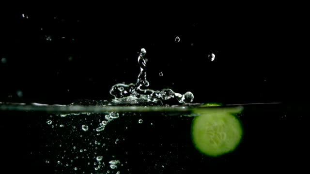 Courgette slices falling in water video