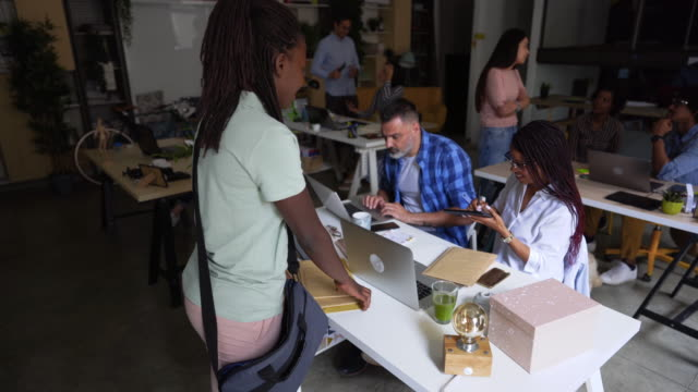 Courier Delivering package in co-working space