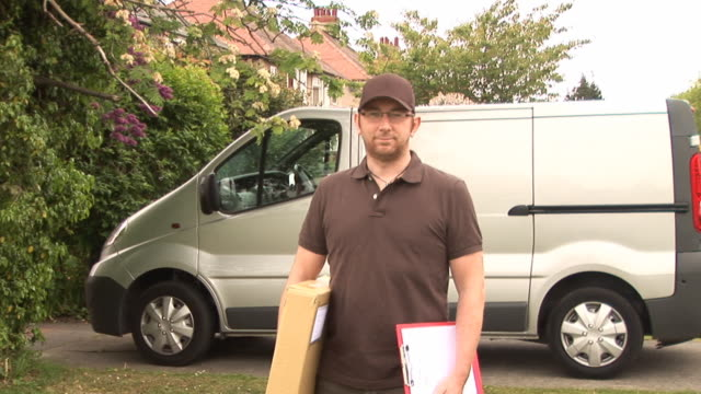 Courier / Delivery man standing - DOLLY video