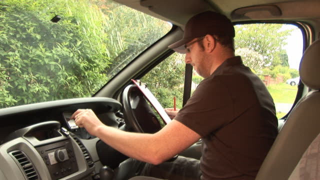 Courier / Delivery Man with GPS / Sat Nav video