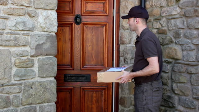Courier home delivery parcel at house - Shipping, Logistics Deliveryman