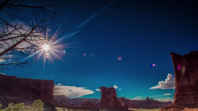 Courthouse arch from arches national park red rock sunny arid hot clear summer day Time Lapse 4K