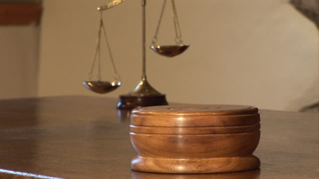 Courtroom, Gavel striking block by Judge with Scales of Justice video
