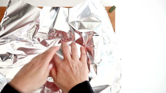 covering a pot with aluminum foil - aluminum foil stock videos & royalty-free footage