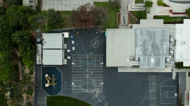stockvideo's en b-roll-footage met covid 19 shelter at home - leeg school baseball field en playground - school