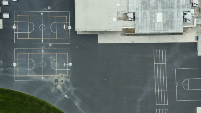 covid 19 shelter at home - empty school baseball field and playground - budynek szkolny filmów i materiałów b-roll