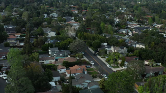 Covid 19 Shelter In Place - Residential Neighborhood Aerial view looking down on a deserted residential community due to the corona virus mandate to shelter at home and follow social distancing. The primary focus is on the empty crosswalk and cross street. stay home stock videos & royalty-free footage