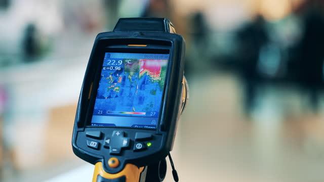 Covid-19 prevention, coronavirus concept. Display of a thermal camera while measuring temperature video