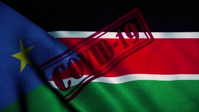 Covid-19 stamp on the national flag of South Sudan. Coronavirus concept