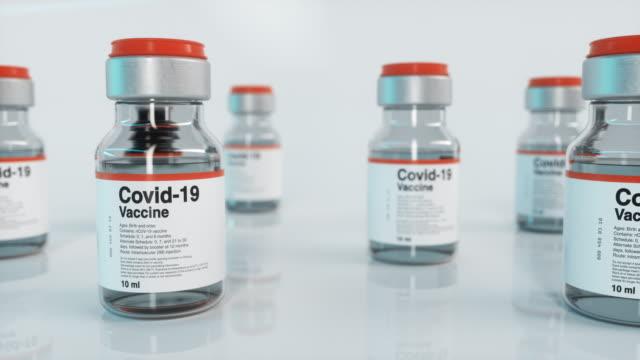 vídeos y material grabado en eventos de stock de vial de la vacuna covid-19, slide - vaccine