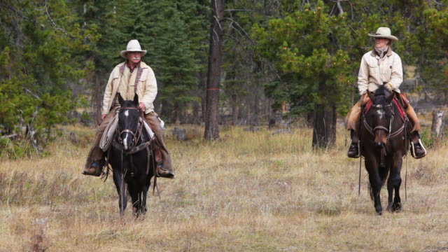 Cowboy and  Cowgirl riding on horseback video