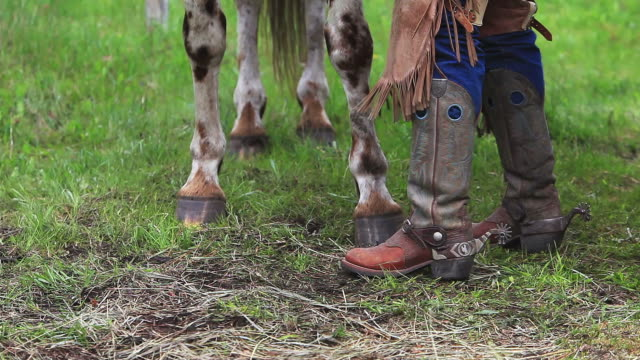Cowboy boots, spurs, chaps and horse hooves video