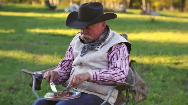 Cowboy eating a steak dinner video