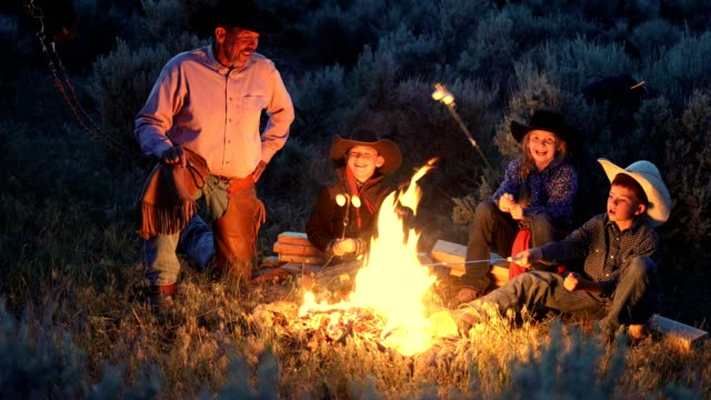 Cowboy Family Campfire Cookout 4k resolution high quality stock video of family enjoying a cowboy campfire cookout in Utah bonfire stock videos & royalty-free footage