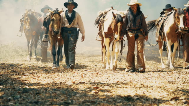Cowboys leading horse walking on the way