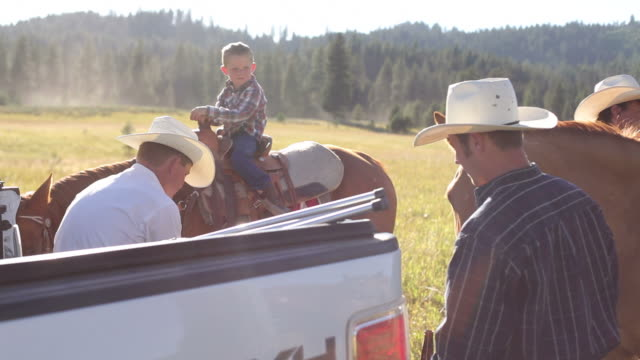 Cowboys take break from herding cattle video
