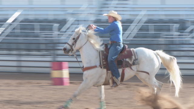 Cowgirl Barrel Racing On Beautiful White Horse Stock Video Download Video Clip Now Istock